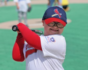 Young Cardinals fan swings his bat for the camera
