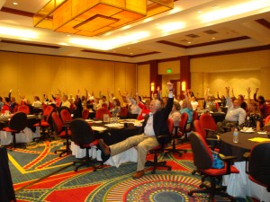 This image shows a large group of conference goers participating in an adaptive stretching break during the CDC Annual Grantees Meeting for all states that have received the Disability and health grant